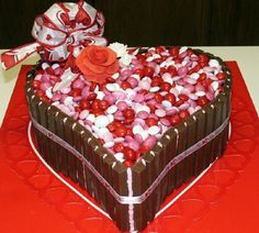 Valentine Candy cake is Darn Good Chocolate Cake filled and frosted with chocolate buttercream.  Roses are gumpaste.  Kitkats, M&M'...