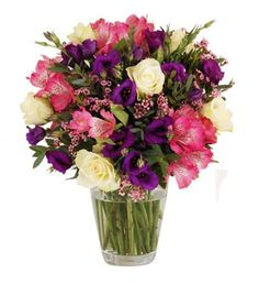 This charming large bouquet has such a pretty combination of purple and pinks with fresh white and silvery green to highlight the pastel tones, all arranged in a beautiful hand-tied bouquet