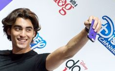 Blake Michael Anaheim, California, USA. 15th Aug, 2015. Blake Michael from the cast of Disney Channel's 'Dog with a Blog' takes fan photos at the Disney D23 Expo
