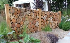 As there are going to lots of high walls in my garden, due to there being three tiers, l think a log wall is a nice way to add interest, variety and reduce impact of walls.