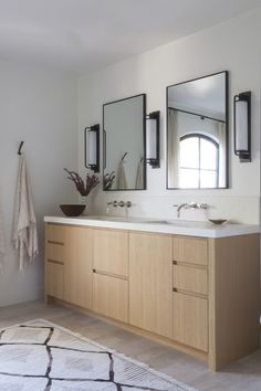 DISC Interiors: A Spanish Colonial Revival Home Transformed, LA Edition: Remodelista : Master Bathroom : White Oak Cabinetry