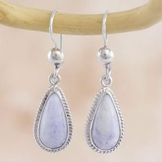 Polished teardrops of natural jade are crowned by silver hemispheres. Zandra Lorena Sajbin selects lilac Guatemalan gems to create earrings of classic beauty.   .925 Sterling silver
