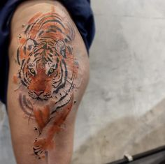Tiger scar cover-up tattoo by Felipe Mello