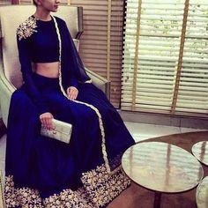 This set features navy blue raw silk lehenga with gold dori work border along…