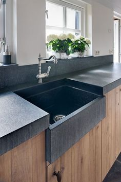 soapstone counter and rustic cabinet fronts