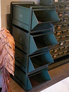 """we have four of these beautiful green vintage storage bins """"model #5"""" from the stackbin company of pawtucket rhode island.  they are much larger than they appear in this photo.  each tray is 15"""" wide x 24"""" deep and 11"""" tall. circa 1950. $250.00 each"""