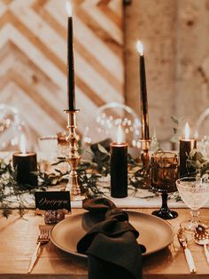 moody and modern wedding tablescapes - https://ruffledblog.com/intimate-modern-romantic-wedding-celebration-the-reception