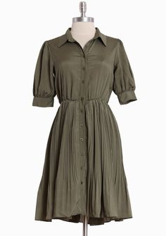 """Lilavati Pleated Shirtdress 54.99 at shopruche.com. Sweet and sophisticated, this olive green shirtdress is ideal for a day out or in the office. Features a pleated skirt, elasticized waist, and a hint of stretch for the perfect fit. Fully lined.  98% Polyester, 2% Spandex,  Imported,  37"""" length from top of shoulder"""