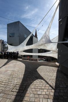 Another sticky tape installation by Numen/For Use.  This one was in Melbourne Australia, and it's very beautiful, I think.  There are videos on the site, including ones of the construction process, but I can't pin them.