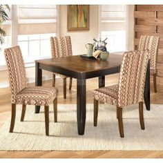 """Alonzo Dining Room Set with Sangria Chairs D367-35-D360-08-set by Ashley Furniture. $817.75. With the warm finishes and comfortable contemporary design, the subtle beauty of the """"Alonzo"""" dining room collection features furniture that is sure to enhance the decor of any dining room. The relaxing two-tone brown finish flows perfectly over the subtle framed details and tapered legs to enhance the stylish contemporary design of this furniture collection. With the ease of th..."""