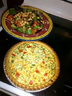 Quiche & chick pea salad  colorful quiche  2 c egg creation  1/2 c milk  1/2 c ricotta cheese  1 c shredded cheese  2 frozen pie crusts  1 chopped red pepper  1 chopped green pepper  1 tsp Mediterranean seasoning  1 tsp oh! So garlic  1 tbsp spinach and herb  Mix in a bowl and pour into pie crusts - Bake @ 400 for 35-40 mins    Salad dressing - mix- 2 Tbsp balsamic vinegar - 1tsp Mediterranean seasoning- 1tsp Thai chili roasted garlic sauce     Mixed greens cucumbers chickpeas tomatoes