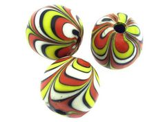 #Beads - Black, Yellow, Red. Shop here: http://happymangobeads.com/black-yellow-red-white-feather-glass-bead-30mm-cb481/ #happymangobeads