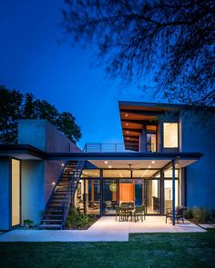Warm lighting gives the trendy home a welcoming appeal after sunset - Decoist