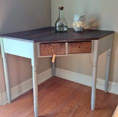 Ethan Allen corner desk. It was falling apart when we bought it. And now, its practically brand new...again. Hand painted in Solitude by Sherwin Williams. The top is stained in Dark Walnut by Minwax.