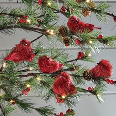"Handmade bristly red bird ornaments are made using paperboard and polyfoam. Metal clip for hanging. 3 1/2"" l x 2 1/4"" w x 2"" h each"