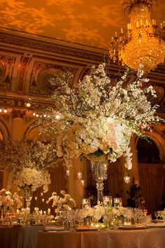 Weddings with glamour   Tall white floral centrepiece