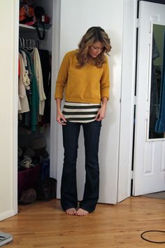 yellow sweater, black and white striped tee