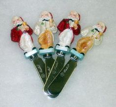 Tuxedo Santa Spreaders by Christopher Radko, Set of 4 (2 each of 2 designs). Home for the Holidays, 2002, 02-6525-0. Dapper Santas are dressed in Tuxedo coats, black bow ties, Santa hat, and carrying a golden wine glass in left hand, right hand behind back. Two santas are in red coats, white pants; two are in cream coats, golden pants.
