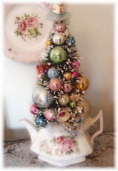 Vintage display of a Christmas tree & ornaments in a teapot Could be great for clothing window