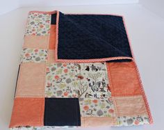 This adorable coral and navy baby quilt is perfect for your forest animal theme nursery, as it also features cute little fox, owl, and bear tea party, all in a beautiful patchwork design. The combination of navy, coral and soft floral makes for a modern, contemporary design ideal for little girls. Meticulously handmade, all of my baby quilts are constructed of a layer of high quality 100% cotton print on the front and a layer of luxuriously teddy-bear-soft Minky Cuddle fabric in navy blue on…