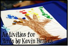 Trace your hand and add birds using finger paints