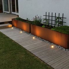 a neutral wooden garden path with a perfectly manicured lawn on one side and met., a neutral wooden garden path with a perfectly manicured lawn on one side and metal garden planters placed on pebbles on the other. Wooden Garden Planters, Diy Planters, Large Outdoor Planters, Wooden Terrace, Terrace Garden, Garden Paths, Landscape Design, Garden Design, Deck Design