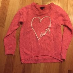 "A heart sweater a pink background sweater with a heart and cursive ""i love you"" written sideways onto the heart. Worn once but washed twice. has some piling on the heart but it looks super cute with it. Kids XL or 16 but fits an adult small or x small. Perfect for Valentines day. Listed as Forever 21 for visibility Forever 21 Sweaters Crew & Scoop Necks"