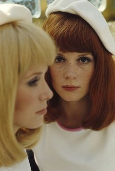 """Ms. Francoise Dorleac and her sister, Ms. Catherine Deneuve in a photograph taken during the shooting of the 1967 film """"The Young Girls of Rochefort""""."""