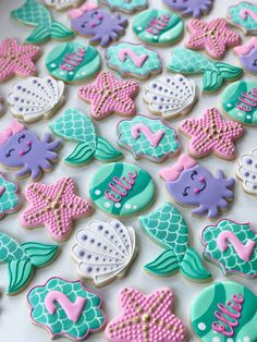 Mermaid Under the Sea Starfish Seashell Octopus Waves Decorated Birthday Cookies Girls Birthday Party Themes Mermaid Birthday Cakes, Baby Girl Birthday, Mermaid Party Food, Mermaid Birthday Party Decorations Diy, 1st Birthday Themes Girl, Mermaid Birthday Decorations, Mermaid Cookies, Seashell Cookies, Girls Party Decorations