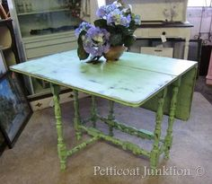 Green gate leg tabled distressed paint.