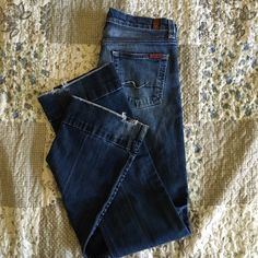 """7 For All Mankind Boot Cut 28 Used bootcut jeans. Measurements, taken laid flat: waist = 15"""", front rise = 8 ½"""", inseam = 33"""", leg opening = 8 ½"""", back rise = 13 ½"""". Please inspect pictures closely to ascertain condition of jeans, such as chafing on the crotch. 7 for all Mankind Jeans Boot Cut"""