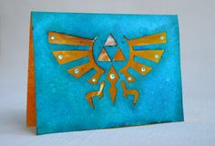 Handmade Zelda-card | Handmade Hyrule logo card. Cutted with using finger knife. Nice card idea for all the game nerds! | By Anski / cute & cool creations