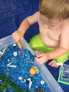 """Play Create Explore: Ocean Sensory Bin    She buried pennies under the rocks so he could dig for """"treasure.""""  Love it."""