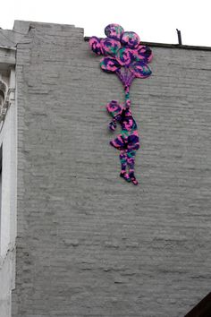 Yarn Graffiti - Wandering on the border of Chinatown and the Lower East Side, I stumbled upon some brightly wound yarn art…