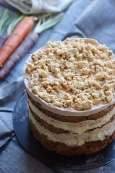 The Momofuku Milk Bar carrot layer cake is absolutely stunning - filled with layers of rich carrot cake, graham cracker frosting, liquid cheesecake, and buttery milk crumb, there is truly a culinary adventure packed into every bite.