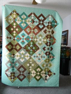 Beautiful brown and aqua quilt.