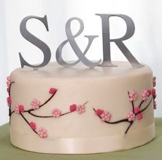 Google Image Result for http://beautyandthegroom.com/wp-content/uploads/2011/03/cheap-cake-toppers-for-wedding-cakes2.jpg