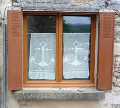 Anchor Curtains: Najac - Aveyron  I love this window with the little crocheted anchor curtains