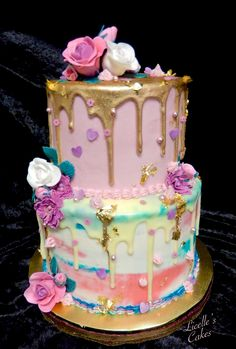 Pale pink and teal birthday cake for a teenage girl. White chocolate drip painted gold and finished with gold leaf, sprinkles and fondant flowers.