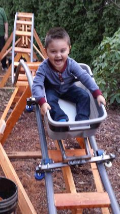 "My nephew Keaton is the first to ride my latest backyard roller coaster, the ""Little Rocket. Outdoor Fun For Kids, Backyard For Kids, Backyard Projects, Backyard Playground, Backyard Zipline, Homemade Roller Coaster, Village Kids, The Ranch, Kids And Parenting"