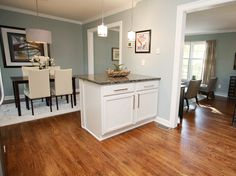 Split Level-opened wall from dining into kitchen and added breakfast bar. Solid wood cabinets from Lowes. Hardware from Ikea. Paint SW7621 #baystreetbungalows #houseflip #remodel #splitlevelflip