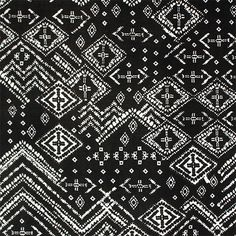 """Vintage Diamond Ethnic on Black Single Spandex Knit Fabric - A variegated scale (smaller to larger) ethnic design in white on a black background single spandex knit.   Fabric has a 4 way stretch, a soft and flowing drape, and is light to mid weight. Pattern repeat is 27"""" (see ruler for scale).  Single spandex knit is a soft and stretchy fabric that is perfect for active wear, swimsuits with a liner, wrap dresses and tops, skirts, and much more!  ::  $6.50"""