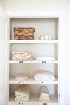 How to organize a hall linen closet