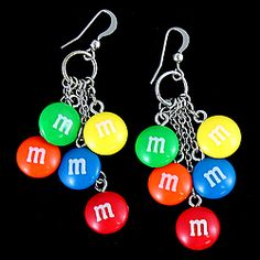 "Add some sweet to your style with darling M&M's charm earrings.  Wire earrings feature M&M charms each dangling on its own silvertone link chain.  2.5"" long.  WARNING: Choking Hazard - small parts.  Not for children under 3 yrs.  Due to health and safety concerns, this item is non-returnable. $13.98"
