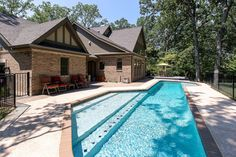 Our Frontenac, MO custom home clients had this very unique pool installed in their backyard with brick coping that matches the home's exterior brick.