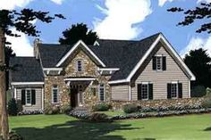 House Plan 46-275. Think this one thru. Enlarge. Convert upstairs to two large rooms. Face front of house to the back. Add upstairs deck from front facing room towards the lake. Tandem or two additional garages.