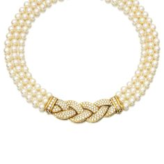 Cultured pearl and diamond necklace, Van Cleef & Arpels, 1980s Designed as three rows of cultured pearls to a clasp of plait design, set with brilliant-cut diamonds.