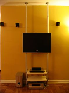 """james has this awesome idea for mounting your television set onfloat mode. also included are shelves for home theatre peripherals neatly tucked under. i love its clutter-free good looks and how amazingly space saving it is. """"since the wall i wanted to mount my tv to is only a 1″ drywall, it would not hold [&hellip"""