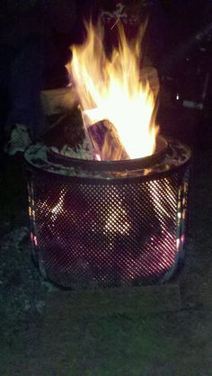 Clever...remains from an old dryer used as a fire pit!!!  Now to find an old dryer on the curb.........