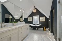 Master bathroom with vaulted ceiling.